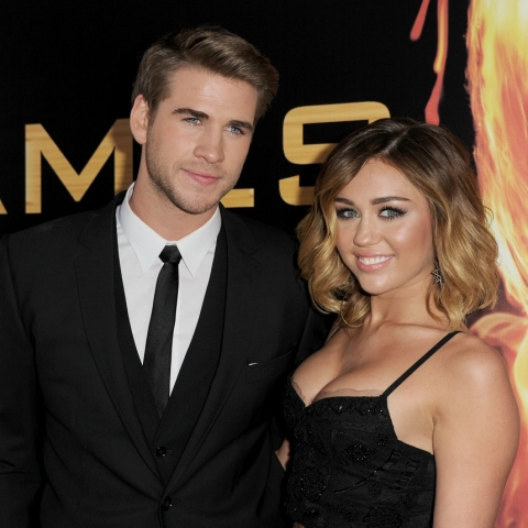 liam-hemsworth-and-miley-cyrus-arrive-at-the-premiere-of-lionsgates-the-hunger-games-at-nokia-theatre-l-a-live-on-march-12-2012