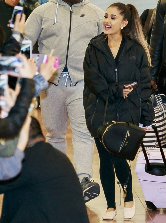 Ariana Grande arrives at Tokyo International Airport greeted by many waiting fans