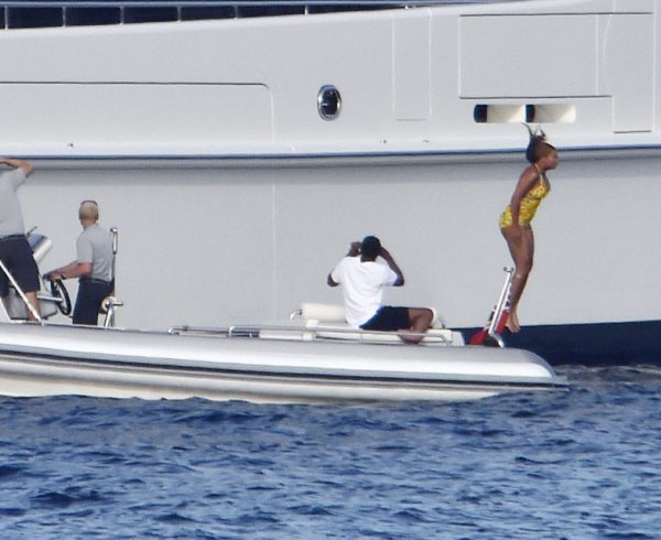 17 AUG 2016 - Sardinia - Italy ***PREMIUM EXCLUSIVE PICTURES-MUST CALL FOR PRICING BEFORE USAGE*** *AVAILABLE FOR UK SALE ONLY* Superstar Singer Beyonce pictured wearing a bright yellow swimsuit as she's seen gathering up some courage to take the Plunge from the highest floor of her Mega Yacht while husband Jay Z films the action and daughter Blue Ivy Looks on in Amazement at her Brave Mum....The happy family are enjoying their Holiday in trendy Porto Rotondo in Sardinia. BYLINE MUST READ : FREZZA-LAFATA-MCP/CIAOPIX ***UK CLIENTS - PICTURES CONTAINING CHILDREN PLEASE PIXELATE FACE PRIOR TO PUBLICATION *** **UK CLIENTS MUST CALL PRIOR TO TV OR ONLINE USAGE PLEASE TELEPHONE 44 208 344 2007**