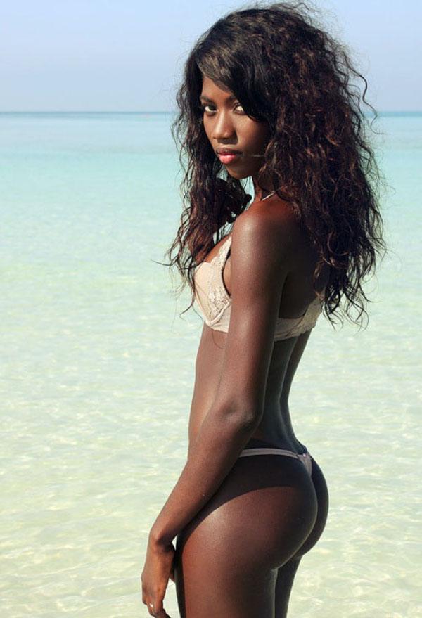 Mixed ebony girl on beach naked